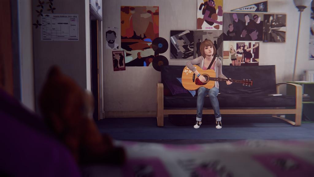 Max joue de la guitare dans sa chambre.